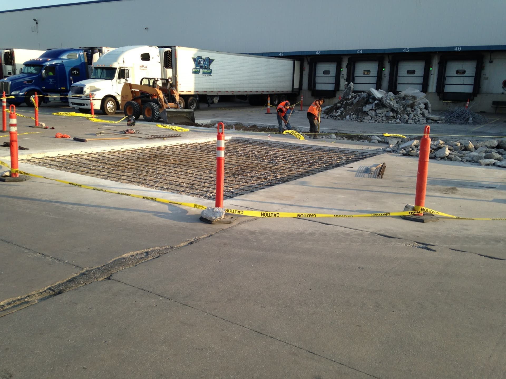 Concrete paving contractors at work