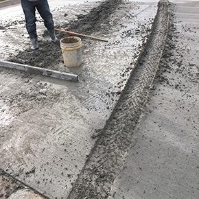Repair tire tracks in wet concrete