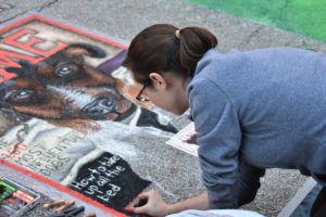 Artist doing street chalk art
