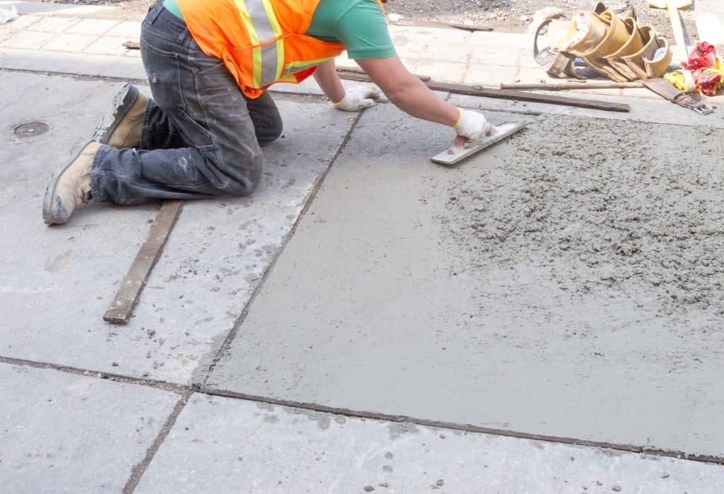 Construction worker paving the concrete